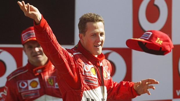 Michael Schumacher - World Champion 94 - 95 - 2000 - 2001 - 2002 - 2003 - 2004 - Page 23 Michael-schumacher-ferrari-lors-de-sa-victoire-au-gp-d-italie-11063013bayfr_1713