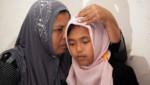 Raudhatul, 14 ans, a retrouvé sa mère 10 ans après le tsunami survenu le 26 décembre 2004 dans l'océan Indien.