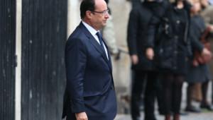 Le président de la République François Hollande aux obsèques de Patrice Chéreau à l'église Saint-Sulpice à Paris le 16 octobre 2013