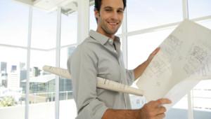Architect with blueprints