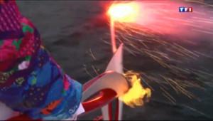 Le 20 heures du 23 novembre 2013 : Plong�de la flamme olympique dans les eaux du lac Ba�l - 1648.084