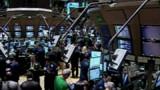 Wall Street au vert grâce aux rumeurs et aux milliards