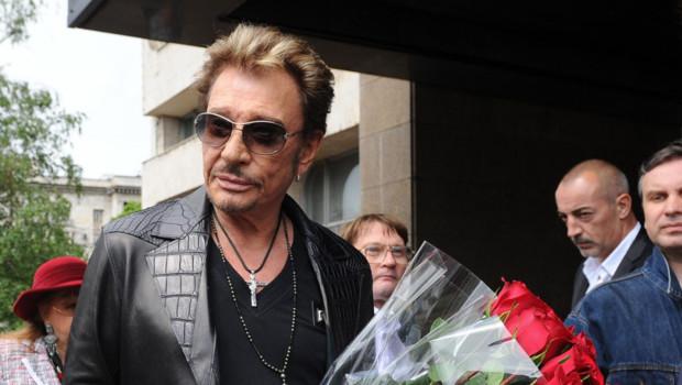 Johnny Hallyday a effectué sa première visite à Moscou pour préparer son unique concert en Russie le 27 octobre 2012. L'arrivée du chanteur pour sa conférence de presse. Le 29 mai 2012.