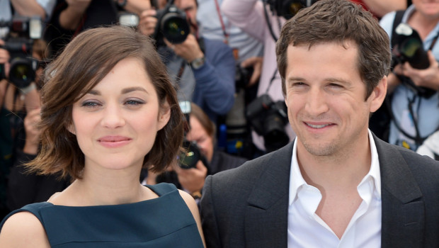 "Guillaume Canet et Marion Cotillard à Cannes le 20 mai 2013 pendant le photo-call du film ""Blood Ties"""