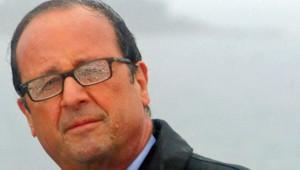 François Hollande à l'île de Sein sous les trombes d'eau le 25 août 2014