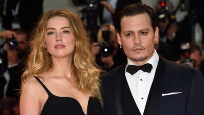 Johnny Depp et Amber Heard à la première de Strictly Criminal lors du Festival de Venise le 4 septembre 2015.