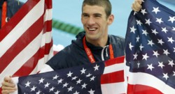 Michael Phelps of the U.S. celebrates after the U.S. won the men's 4x100m medley relay swimming final at the National Aquatics Center in Beijing 2008 Olympic Games