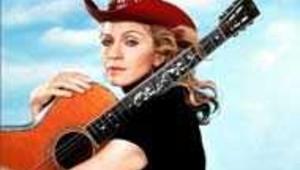La chanteuse Madonna avec une guitare