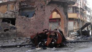 Dégâts causés à Homs par l'armée syrienne, 10/4/12 (photo fournie par l'opposition)