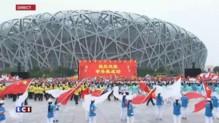 Pékin organisera les JO d'hiver 2022, scènes de joie devant le stade national