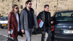Nikola Karabatic, son amie Géraldine Pillet et son avocat Michael Corbier (à droite) arrivant au tribunal de Montpellier le 29 janvier 2013