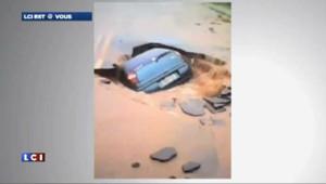 """Brésil : une voiture """"avalée"""" par une route"""