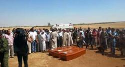 Les cercueils d'Aylan, de son frère et de sa mère à Kobané le 4 septembre 2015