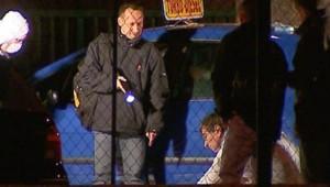 TF1/LCI : Enquêteurs sur les lieux d'une fusillade à Grenoble, le 24 février 2007