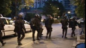 Des policiers à Grenoble, le 4 août 2010.