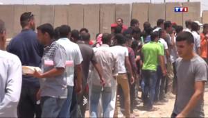 Le 20 heures du 19 juin 2014 : Irak : les habitants de Bagdad se pr�rent �utter contre les jihadistes - 1048.141690307617