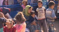 Le 13 heures du 22 septembre 2014 : Les r�gi�kurdes de Syrie affluent en Turquie - 838.211