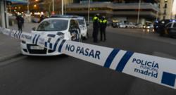 Police devant le siège du Parti populaire en Espagne après l'attaque à la voiture commise par un chef d'entreprise désespéré, 19/12/14