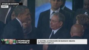 Barack Obama et Raul Castro se serrent la main pour la première fois lors de l'hommage à Nelson Mandela à Soweto le 10 décembre 2013