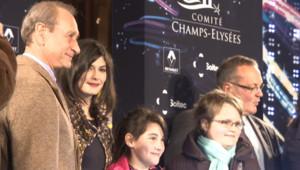 La comédienne Audrey Tautou et le maire de Paris Bertrand Delanoë ont déclenché le 23 novembre 2011 les illuminations de Noël des Champs-Elysées