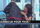 Un tablier présenté par Estelle Denis dans l'émission J'achète (ou pas).