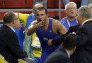 Ara Abrahamian of Sweden argues with referee Jean-Marc Petoud of Switzerland at the Beijing 2008 Olympic Games