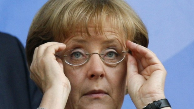 german-chancellor-merkel-adjusts-her-eyeglasses-before-euro-2541796_1713.jpg?v=1