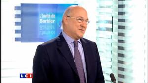 """Sapin : Hollande, """"une détermination ancienne"""" pour la présidentielle"""
