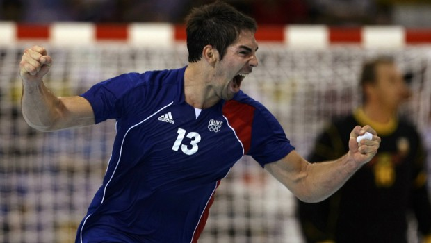 Nikola Karabatic of France celebrates after scoring during their men's preliminary round Group A handball match against Spain at the Beijing 2008 Olympic Games
