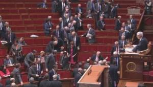 Des députés UMP quittent l'Assemblée nationale le 24 février 2014.