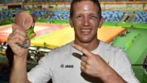 Dirk Van Tichelt, sa médaille de bronze et son œil au beurre noir