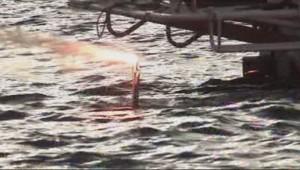 La flamme olympique dans le Lac Baïkal