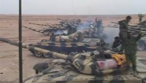 Après Ajdabya, des chars du régime de Kadhafi avancent vers la ville insurgée de Benghazi, le 16 mars 2011