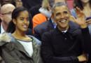 Malia et Barack Obama regardent un match de Basketball universitaire dans le Maryland. Novembre 2013