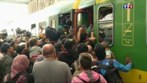 Le 13 heures du 3 septembre 2015 : Gare de Budapest : bloqués, les migrants prennent d'assaut les trains - 575