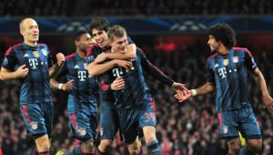 Les Munichois célèbrent le premier but, signé Tony Kroos, face à Arsenal en 8e finale de la Ligue des champions le 19 février 2014 à Londres.