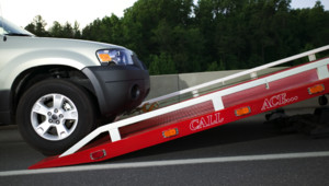 SUV being loaded on tow truck
